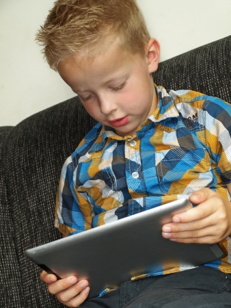 Child on tablet pc Stock Photo - 17789179
