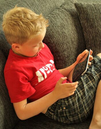Boy on tablet pc photo