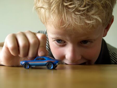 Boy playing with toy car concept Stock Photo - 18242693