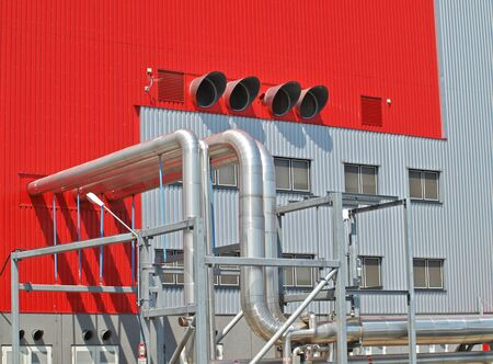 Industrial pipes on the outside of a power plant factory photo