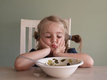 hungry kid: Not hungry Stock Photo