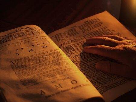 jehovah: Reading bible in candlelight