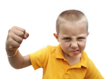 Bullying child wanting to fight waving with his fist photo