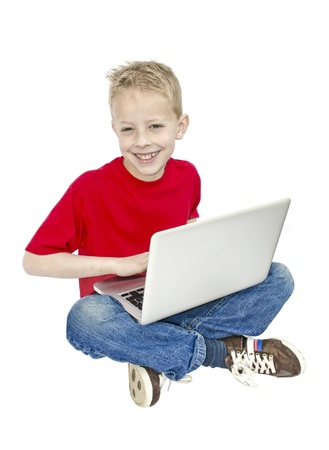 Studio shot of a young child on a laptop computer isolated on a white background Stock Photo - 18242705