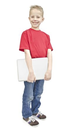 eager: A young boy holding a laptop isolated on a white background