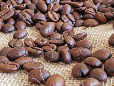 Coffee beans on fabric from a bag Stock Photo - 18236740