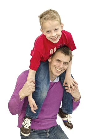 Son on fathers neck having fun Stock Photo - 18242956