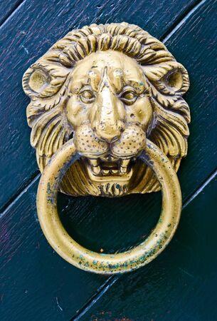 knocker: Old lionhead door knocker
