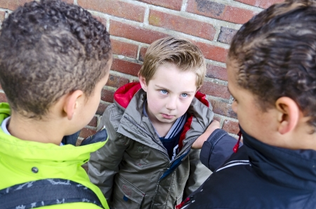 Two boys bullying little kid