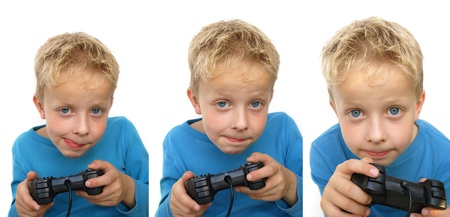 kids playing video games: young kid gaming Stock Photo