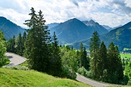 Alpine road in forest and mountains Stock Photo - 18661888