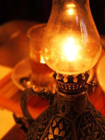 burning old oil lamp photo