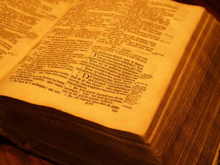 Old bible in candlelight Stock Photo - 18553496