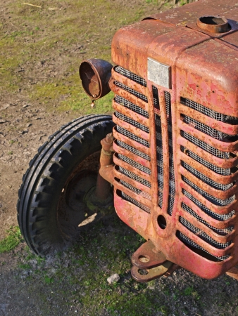 Old vintage tractor left outside to rust photo
