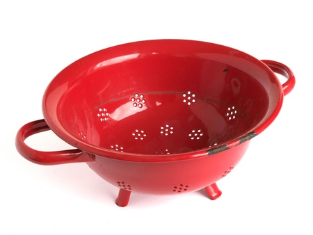 a colander: Red colander or strainer isolated