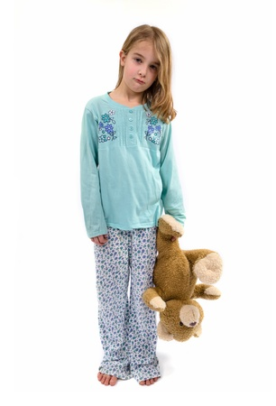 angry teddy: Sad girl in pajamas wit teddy bear Stock Photo