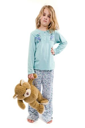 Angry girl in pajamas with teddy bear photo