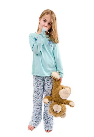 angry teddy: Cute girl in pajamas with teddy bear