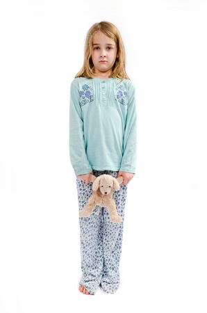 angry teddy: Scared girl in pajamas wit teddy bear