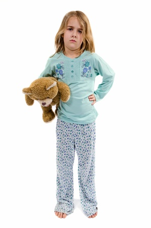 angry teddy: Angry girl in pajamas with teddy bear Stock Photo