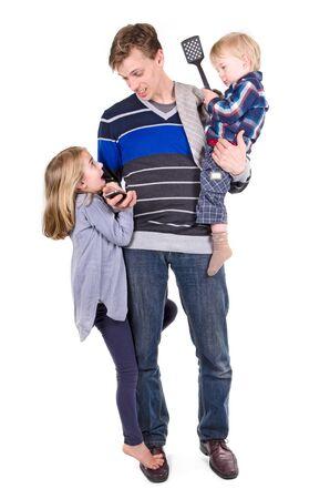 babysitting: Father working and babysitting his children