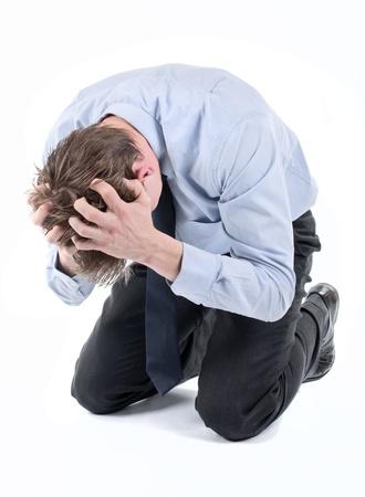 Stressed businessman on his knees