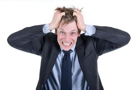 Stressed businessman lui tirant les cheveux Banque d'images