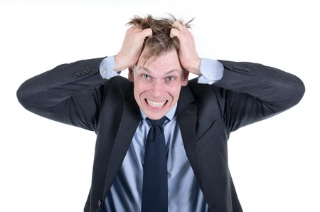 Stressed businessman pulling his hair photo