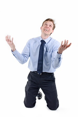 Stressed businessman on his knees praying for help