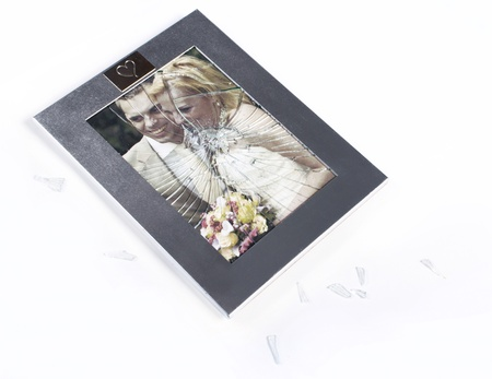 Broken picture frame of married couple