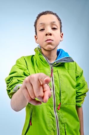 Big bully boy harassing small child