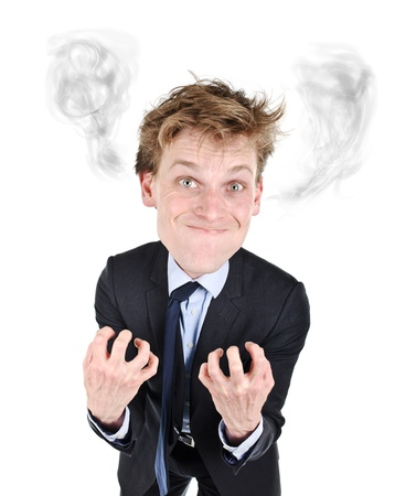 Very upset businessman smoking from anger from his ears photo
