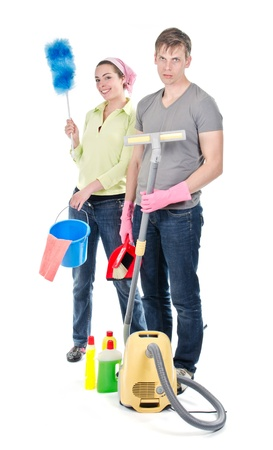 Grumpy man and happy wife cleaning the house Stock Photo - 19587706