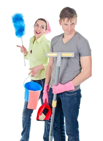 Grumpy man and happy wife cleaning the house