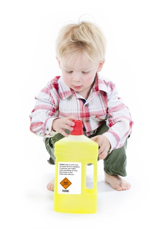 household accident: Child playing with dangerous or toxic cleaning materials Stock Photo