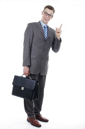 Nerd or goofy businessman with suitcase photo