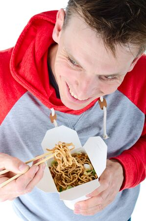 Man eating chinese take away food with chopsticks photo