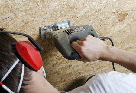 handsaw: Cutting plywood with electric handsaw