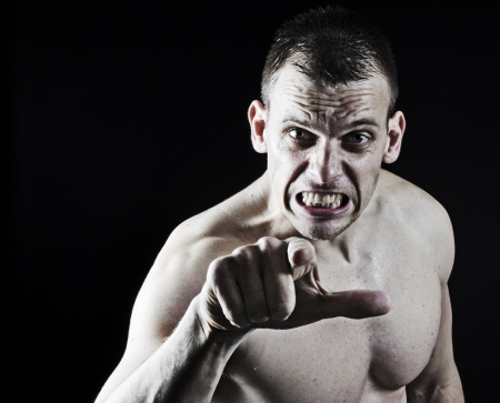 Very angry muscular man pointing to the camera photo