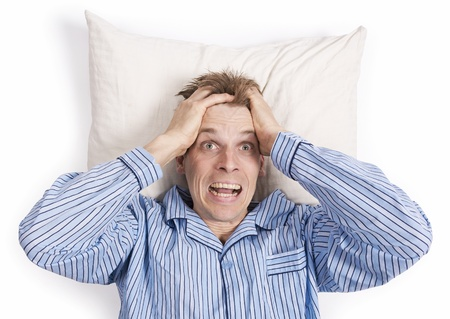 bad economy: Stressed man in bed cant sleep