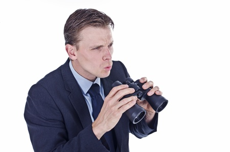 predict: Businessman holding binocular concept of bad financial forecast Stock Photo