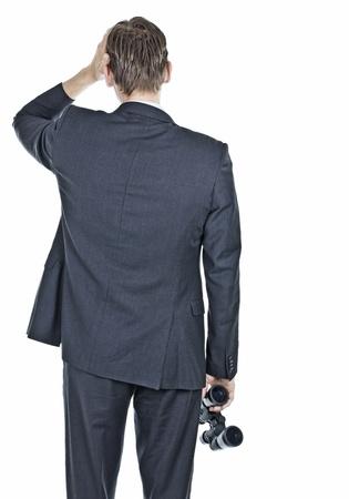 Businessman worried and holding binocular
