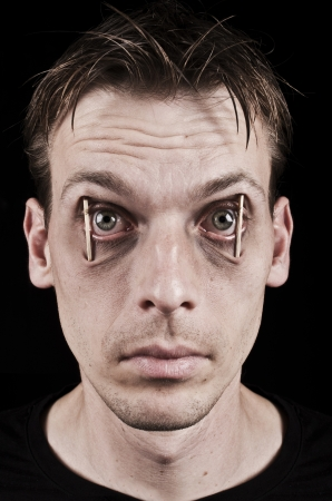 eyes wide: Workaholic or sleepless man Stock Photo