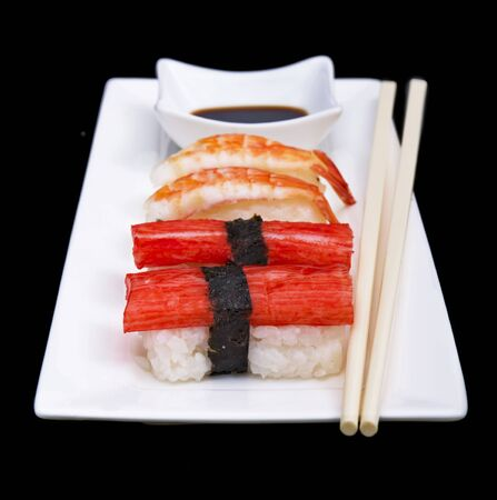 White plate with sushi and chopsticks photo