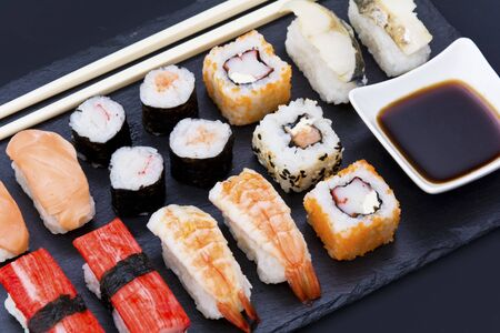 Black stone plate with sushi chopsticks and sauce Stock Photo - 20875730