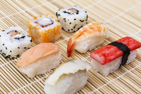 Bamboo table mat with sushi close up Stock Photo - 20875731