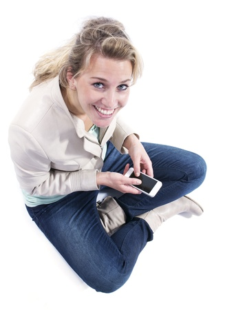 Young woman with smartphone Stock Photo - 21077600