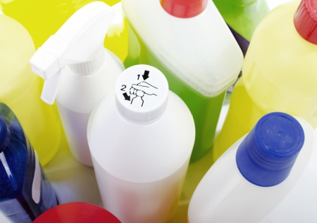 children's: Children s safety cap on cleaning bottles Stock Photo