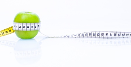Concept of health apple with measuring tape on reflecting white background Stock Photo - 21694486