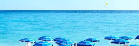Concept of holiday blue beach with parasols in Nice Stock Photo - 21694490
